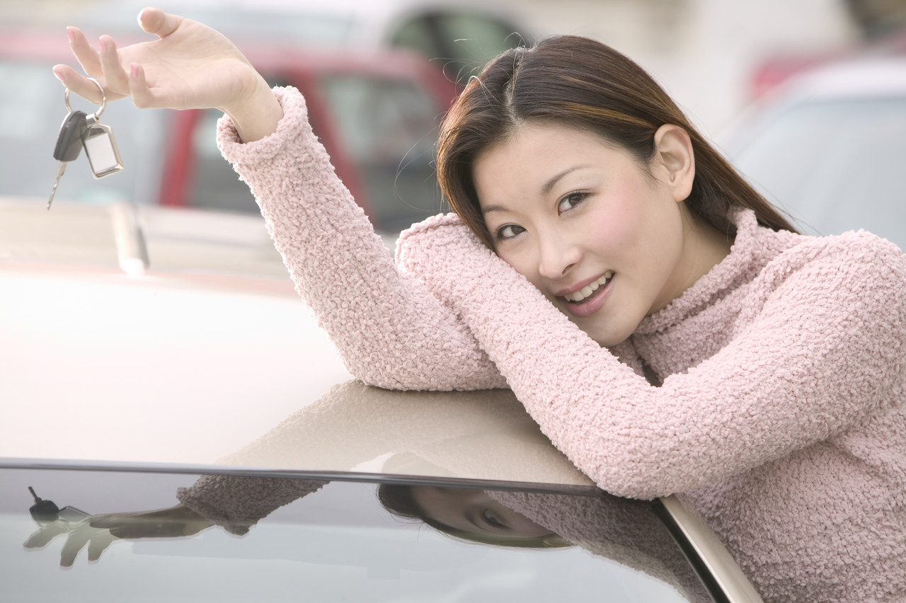Smiling Woman Holding Car Keys